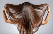 Back view of a brunette woman with a long straight hair. Young   model with  beautiful hair - isolat poster