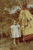 image of wigwams  - Vintage photo of  little girl and toy wigwam  - JPG