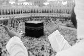 stock photo of mekah  - Muslim man praying at Kaaba - JPG