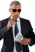 stock photo of hustler  - Businessman with cigar and money - JPG