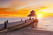 foto of dhoni  - Awesome vivid sunset over the jetty in the Indian ocean - JPG