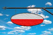 Poland Flag On Signboard. Oval Signboard Colors Poland Flag Hanging On A Metal Forged Structure. Tem poster
