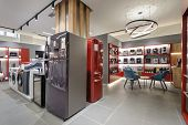 refrigerators, washing machines and coffee machines in the premium home appliance store poster