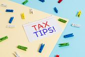 Handwriting Text Tax Tips. Concept Meaning Compulsory Contribution To State Revenue Levied By Govern poster