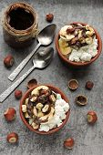 Keto Breakfast Or Dessert. Cottage Cheese With Banana, Hazelnuts And Chocolate Paste. Keto Diet. poster