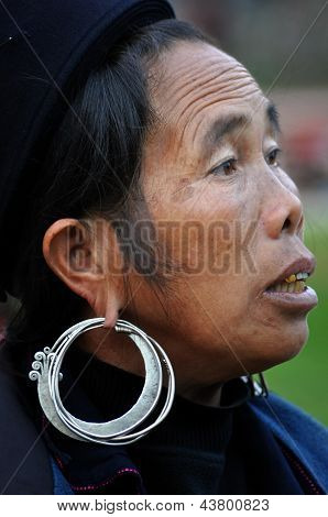 Black H'mong Vietnamese woman with a silver earring. Sapa, Vietnam