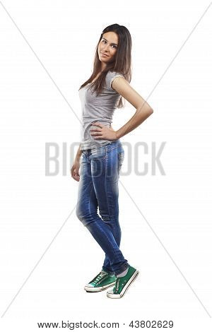 Portrait Of An Attractive Young Woman Standing Against Isolated Background