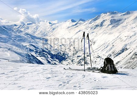 Skis, Ski Poles And Backpack In Alps