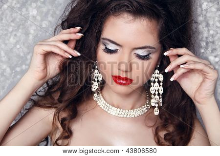 Fashion Portrait Of Beautiful Woman With Perfect Make Up Over Party Lights. Jewelry And Beauty.