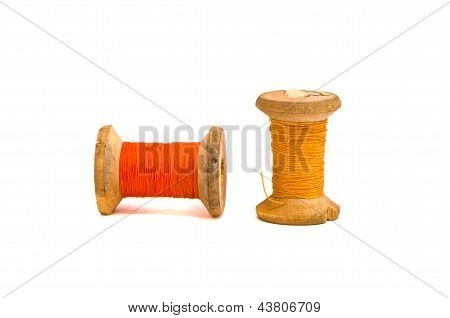 Old Grunge Thread Spools Isolated On White