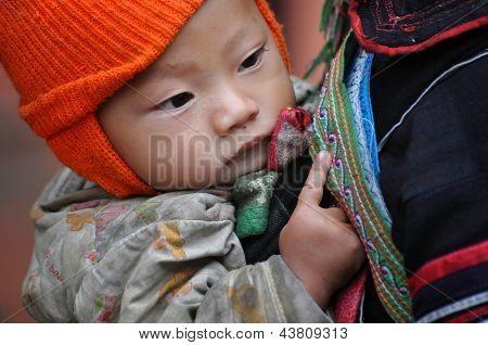 Black Hmong woman carrying her child, in Sapa, Vietnam