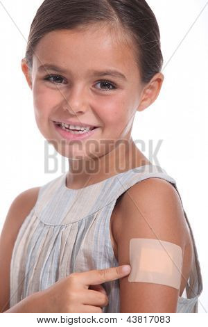 A girl wearing an adhesive bandage