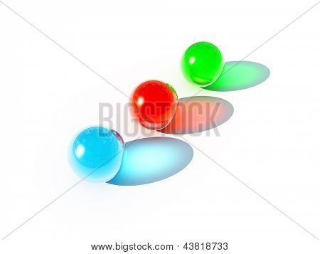 three bright balls of different colors on a white background