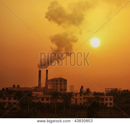 sugar mill polluting the atmosphere with smoke and smog