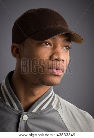 Young African American Male Low Key Portrait on Grey Background