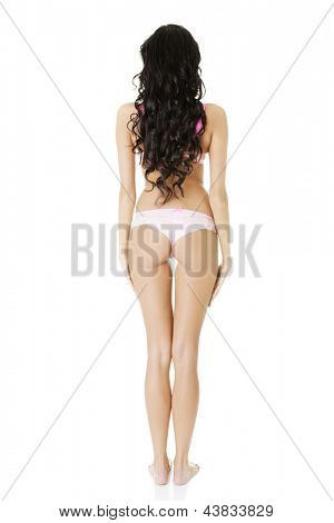 Rear view of taned fit woman in underwear. Diet, healthy lifestyle and body care concept.