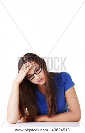 Young sad teen woman, have big problem or depression, over white background