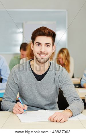 Happy student studying in an university class