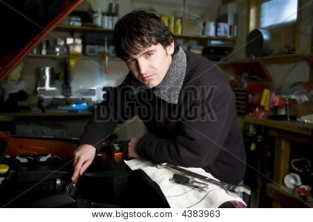 Mechanic In His Workshop