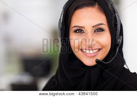 beautiful middle eastern businesswoman with headphones closeup head shot