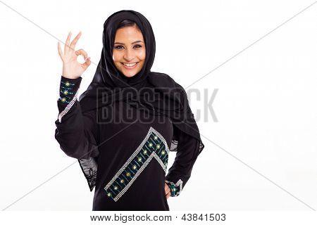 beautiful modern arabian woman giving ok hand sign