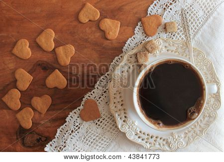 Coffee cup and cookies on a wooden table