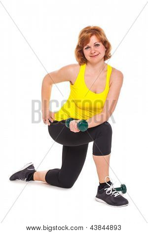 Happy middleaged woman exercising with dumbbells isolated over white background