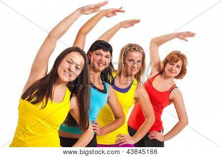 Group of women exercising over white background