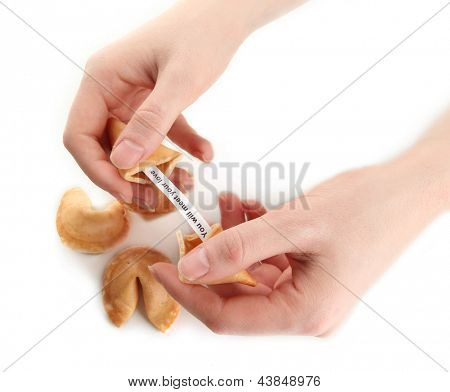 Woman holding fortune cookie, isolated on white