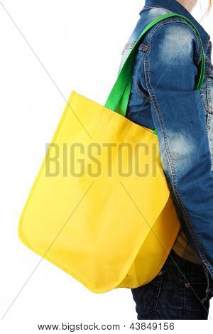Yellow bag with green handles on shoulder isolated on whit