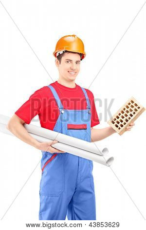 Male construction worker holding a brick and a blueprint isolated on white background