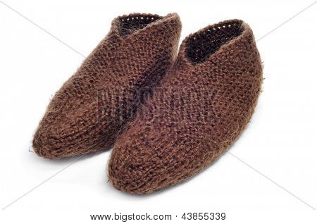 a pair of knitted brown bootees on a white background