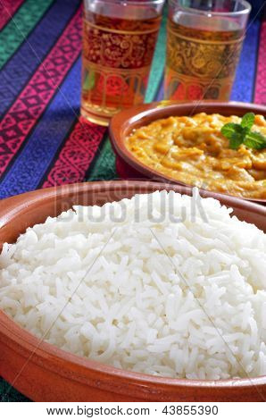 closeup of some bowls with basmati rice and korma curry