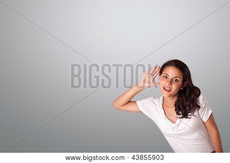pretty young woman gesturing with copy space