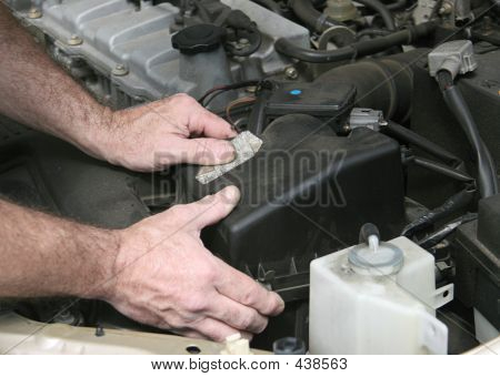 Mechanic Hands On Filter Cover
