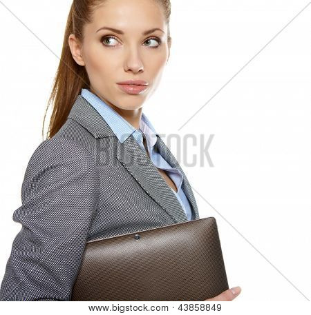 young attractive business woman uses a mobile tablet computer with touch screen