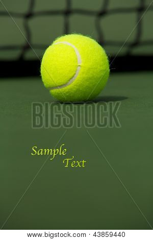 Tennis Ball isolated on the court with room for copy