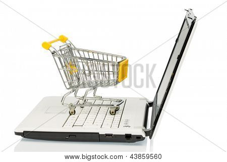 an empty cart on a laptop computer. symbolic photo for internet shopping