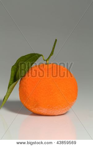 an orange is on a white background. representative photo of healthy vitamins from fresh fruit