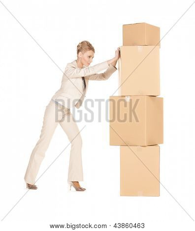 picture of attractive businesswoman moving big boxes