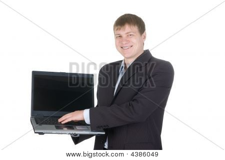 Smiling Businessman Holding A Laptop With White Screen