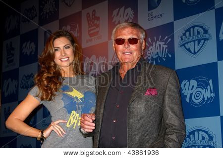 LOS ANGELES - MAR 21:  Katherine Webb, Adam West arrive at the Batman Product Line Launch at the Meltdown Comics on March 21, 2013 in Los Angeles, CA