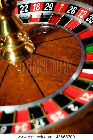 Top view of wooden roulette at the gambling house