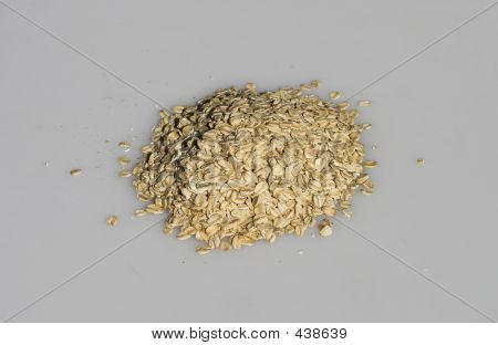 Oatmeal Piled On Grey Background