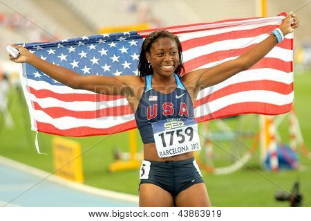 BARCELONA - JULY, 13: Erika Rucker of USA celebrating his medal during the 20th World Junior Athletics Championships at the Olympic Stadium on July 13, 2012 in Barcelona, Spain