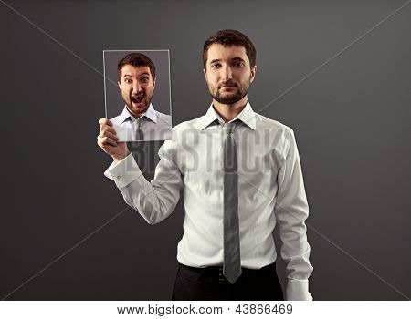 serious and calm businessman don't showing his indignation