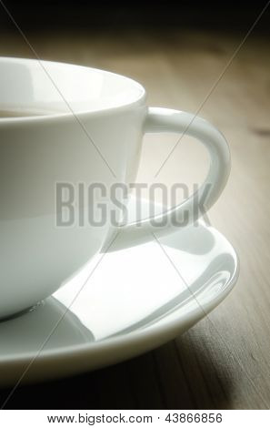 Cup of tea on wooden background, detail