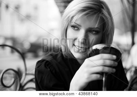 Young woman with dessert at sidewalk cafe