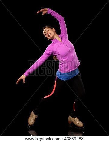 Young adult figure skater. Studio shot over black.
