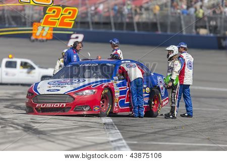 FONTANA, CA - MAR 24, 2013:  The AAA Ford Fusion driven by Joey Logano (22) sits on pit road after an altercation with Tony Stewart at the end of the Auto Club 400 race in Fontana, CA on Mar 24, 2013.